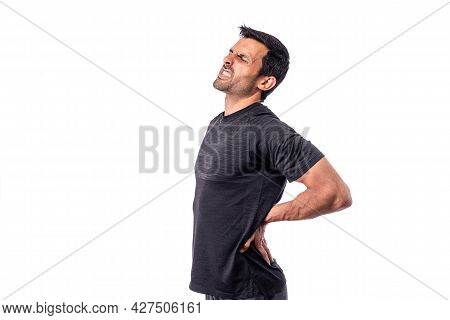 Athletic Middle-aged Man With Pain In The Spine. Spine Treatment. On An Isolated White Background. C