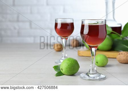 Delicious Liqueur And Fresh Walnuts On Wooden Table