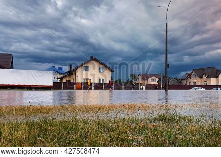 Minsk, Belarus - June 26, 2021. Flooding After Heavy Rain. People Went Out And Watched The Consequen