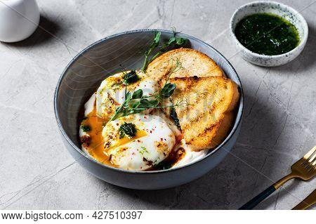 Cilbir Or Turkish Eggs. Poached Eggs Topped Over Herbed Greek Yogurt, Drizzled With Hot Paprika Oliv