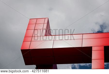Details Of Aluminum Facade With Colorful Red Panels On Large Shopping Mall Over Sky Background
