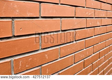 Red Brick Wall In Perspective. Masonry Brickwork Background. Abstract Backdrop.