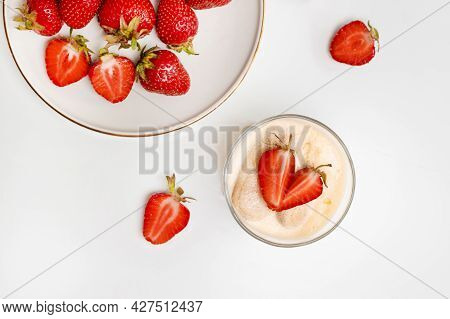 Fresh Strawberries In Plate With A Delicate Tiramisu Dessert On White Wood Table