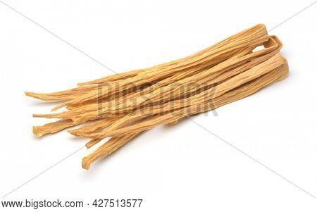 Dried tofu skin sticks isolated on white