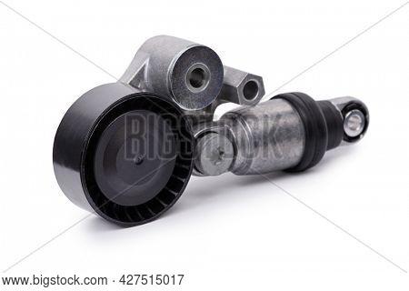 Alternator car belt tensioner roller for V-ribbed belt, engine part isolated on white background