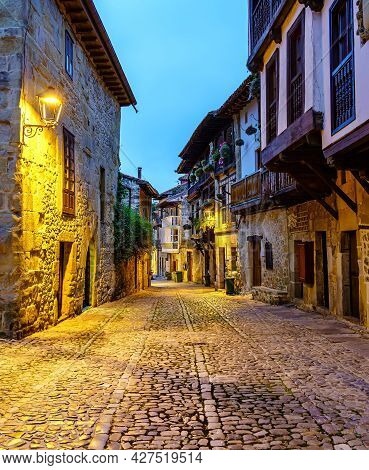 Narrow Stone Old Town Alley With Cobbled Streets. Santillana Del Mar.