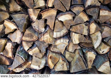 Woodpile With Chopped Wood. Procurement Of Fuel For The Winter.