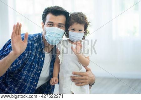 Father And Daughter Wear Face Masks, Both Are Wearing Face Masks For Confidence In Their Health.  Pr