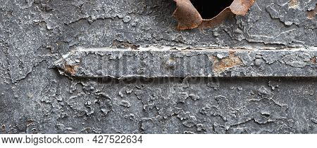 Fragment Of An Old Metal Surface With Paint Cracked From Time To Time
