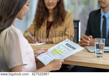 Young Asian Woman Graduate Holding The Resume Document And Preparing To Two Manager Before Start To