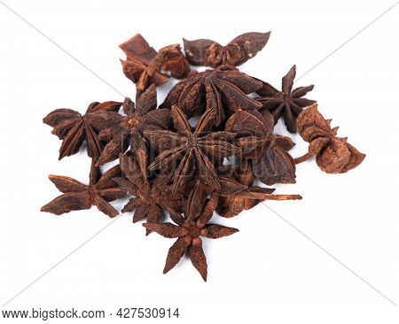 Heap of dry anise stars isolated on white background