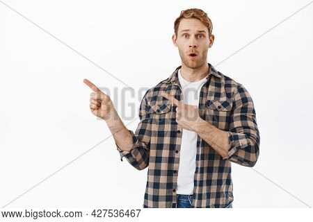 Wow Thats Awesome. Impressed Redhead Guy, Pointing Left, Showing Advertisement Copy Space, Making An