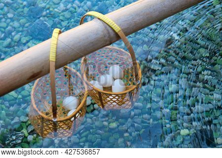 Close Up Hanging Onsen Eggs In Basket On Bamboo Rod,eggs Boiled In Hot Spring To Make Hot Spring Egg