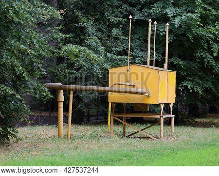Yellow Metal Box Of A Gas Distributor In A Green Garden