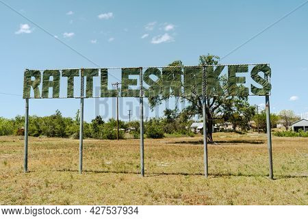 Old Rattlesnakes Sign Along Route 66 In Mclean Texas