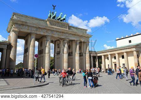 Berlin, Germany - August 27, 2014: People Visit Brandenburg Gate In Berlin. Berlin Is Germany's Larg