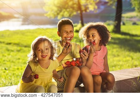 Children, Eating Healthy Organic Food, Fresh Berries As Snack.happy Children Girl And Boy Brother An