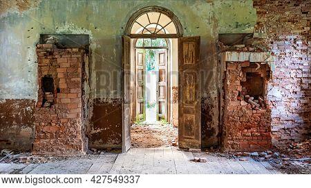 Inside Interior Of An Old Abandoned Church In Latvia, Galgauska, Entrance Door And Brick Wall