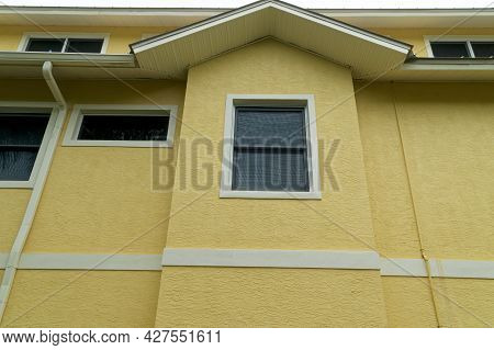 View Of Exterior Of Generic Florida Building Or Home Showing Roof Peak.
