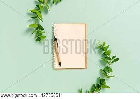 Creative Flat Lay Photo Of Workspace Desk. Top View Office Desk With Open Mockup Blank Notebooks And