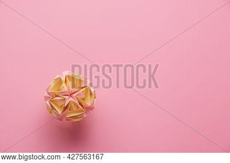 Multicolorhandmade Modularorigami Ball Or Kusudama Isolated On Pink Background. Visual Art, Geomet