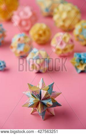 Set Of Multicolorhandmade Modularorigami Balls Or Kusudama Isolated On Pink Background. Visual Art