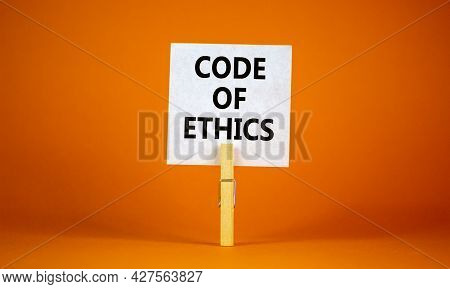 Code Of Ethics Symbol. White Paper With Words 'code Of Ethics', Clip On Wood Clothespin. Beautiful O