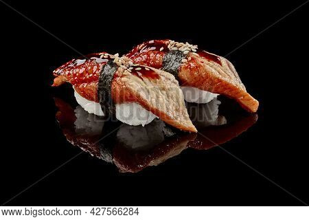 Two Nigiri Sushi With Eel, Unagi Sauce And Sesame