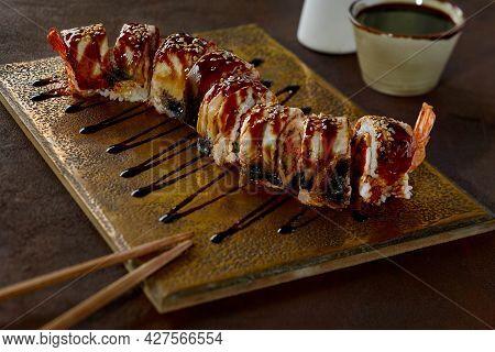 Shrimp, Tobiko And Cucumbers Sushi Rolls With Eel And Unagi Sauce