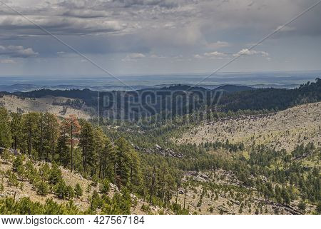 Black Hills, Keystone, Sd, Usa - May 31, 2008: Custer State Park. Rain Over Green And Dry Brown Land