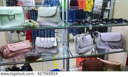 Fashionable Women's Handbags In Pastel Color On Shop Window. Clothing And Accessories Fashion Boutiq