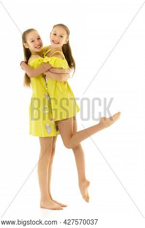 Side View Of Barefoot Teen Girls Looking At Each Other Standing On One Leg On Toes, Two Beautiful Si