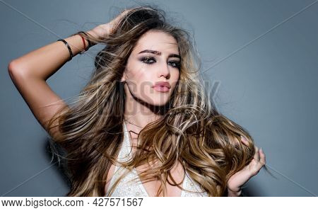 Beautiful Young Woman With Clean Perfect Skin. Blonde Girl With Curly Hairstyle And Red Lips. Girl W