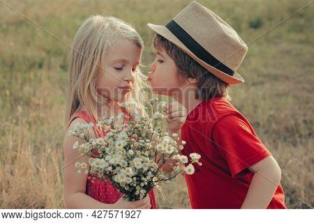 Lovely Children. Kids Love Story, Kiss. Beautiful Little Couple - Boy And Girl Embracing. Summer Por