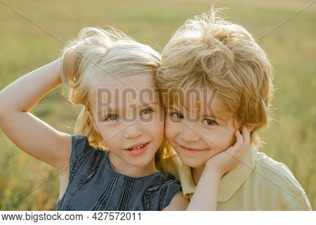 Kids Having Fun In Field Against Nature Background. Valentines Day Cupid Child. Child With Angelic C