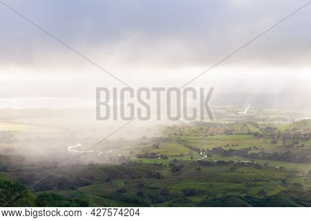 Mountain Landscape With Valley Under Cloudy Sky On A Rainy Sunny Morning. Montana Redonda, Dominican