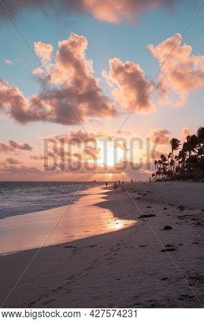 Tropical Sunrise At Atlantic Ocean Coast. Bavaro Beach, Dominican Republic, Vertical Coastal Landsca