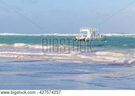 Coastal Caribbean Landscape. White Pleasure Motorboat Is Moored Near Bavaro Beach, Dominican Republi