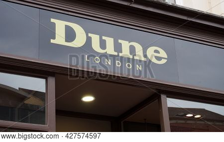 Leeds, West Yorkshire, United Kingdom - 7 July 2021: Sign Above The Dune Retail Footwear Store On Br