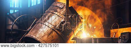 Heavy Metallurgy Horizontal Banner Background. Iron Cast Process. Liquid Molten Metal Pouring Into M