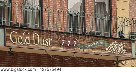 Deadwood Sd, Usa - May 31, 2008: Downtown Main Street. Closeup Of Gold Dust Casino And Hotel Emblem