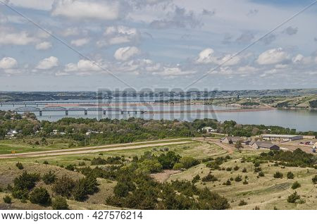 Chamberlain, Sd, Usa - June 2, 2008: The 3 Missouri River Crossings Under Blue Cloudscape. Farm With