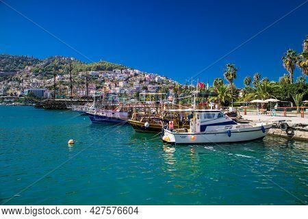 Alanya , Turkey- October 20, 2020:  Sea pier port for yachts and boats in marina on a background of mountainous terrain in Alanya, Turkey.