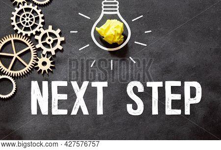 Next Steps Written On A Chalkboard. Business Concept