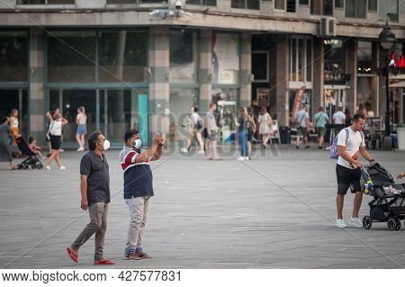 Belgrade, Serbia - July 12, 2021: Indian Tourists, Two Middle Aged Male Men From India, Taking Pictu