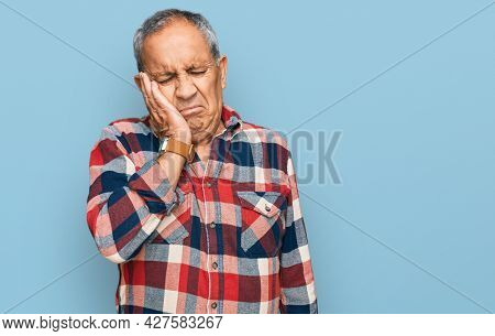 Senior hispanic man wearing casual clothes thinking looking tired and bored with depression problems with crossed arms.