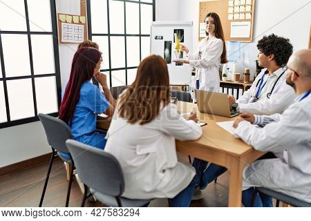Group of young doctor discussing in a medical meeting at the clinic office.