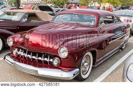 Homestead, Pennsylvania, Usa July 21, 2021 A 1951 Maroon Mercury Custom Coupe On Display At A Summer