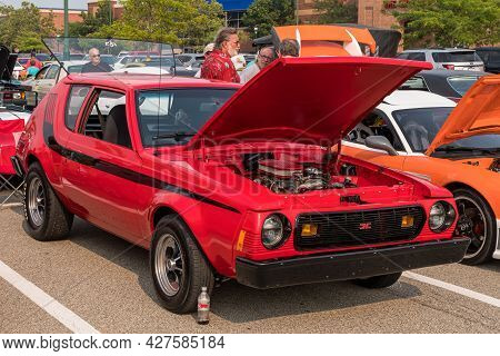 Homestead, Pennsylvania, Usa July 21, 2021 A 1977 Red With Black Stripes Amc Gremlin With A Modified