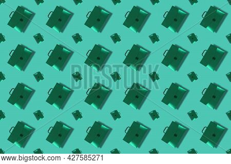 Monochrome Composition With Green Briefcases With Handle On Green Background. Closed Plastic Repeati